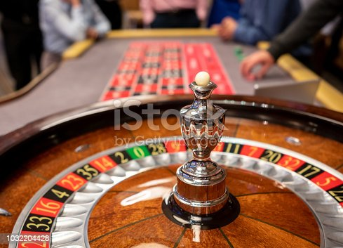 Close up of roulette wheel at the casino - Focus on foreground