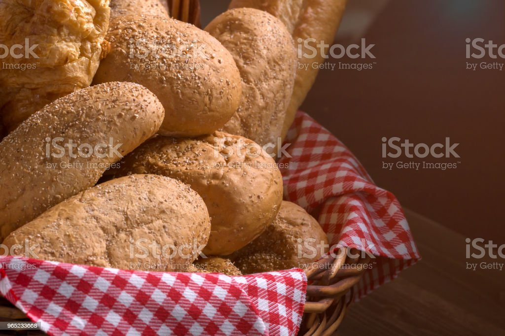 Close up of round bun bread in the basket on black background royalty-free stock photo