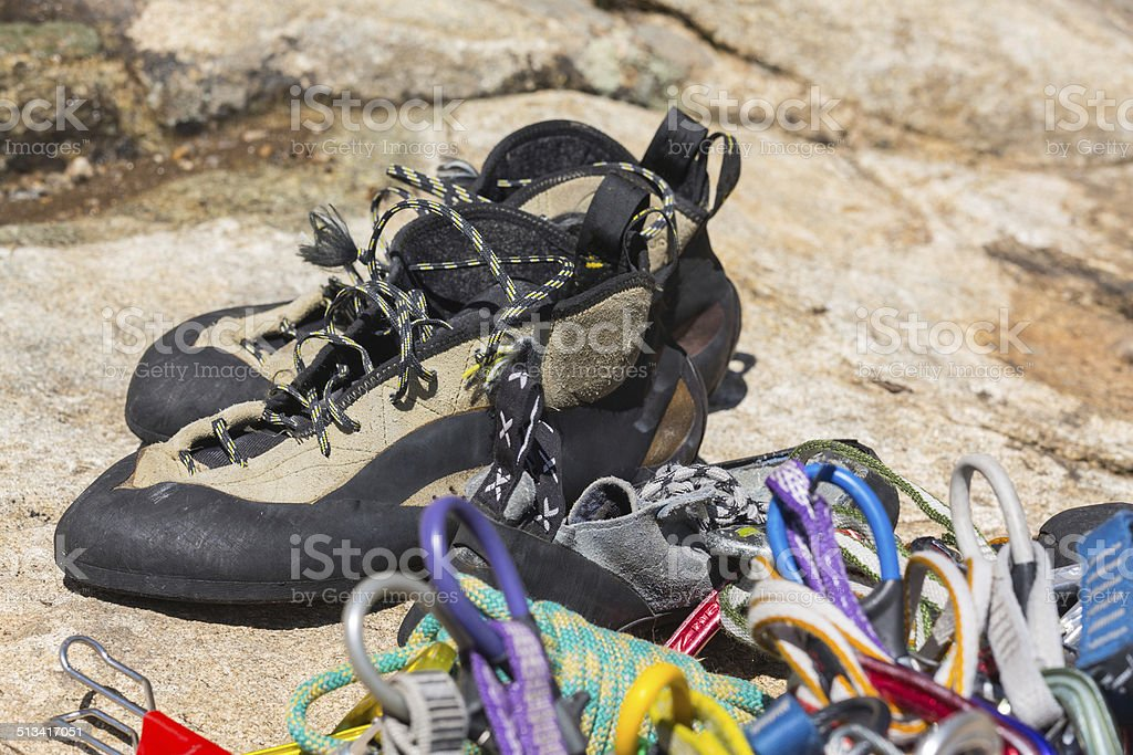 Close up of rubber climbing shoe on rock stock photo