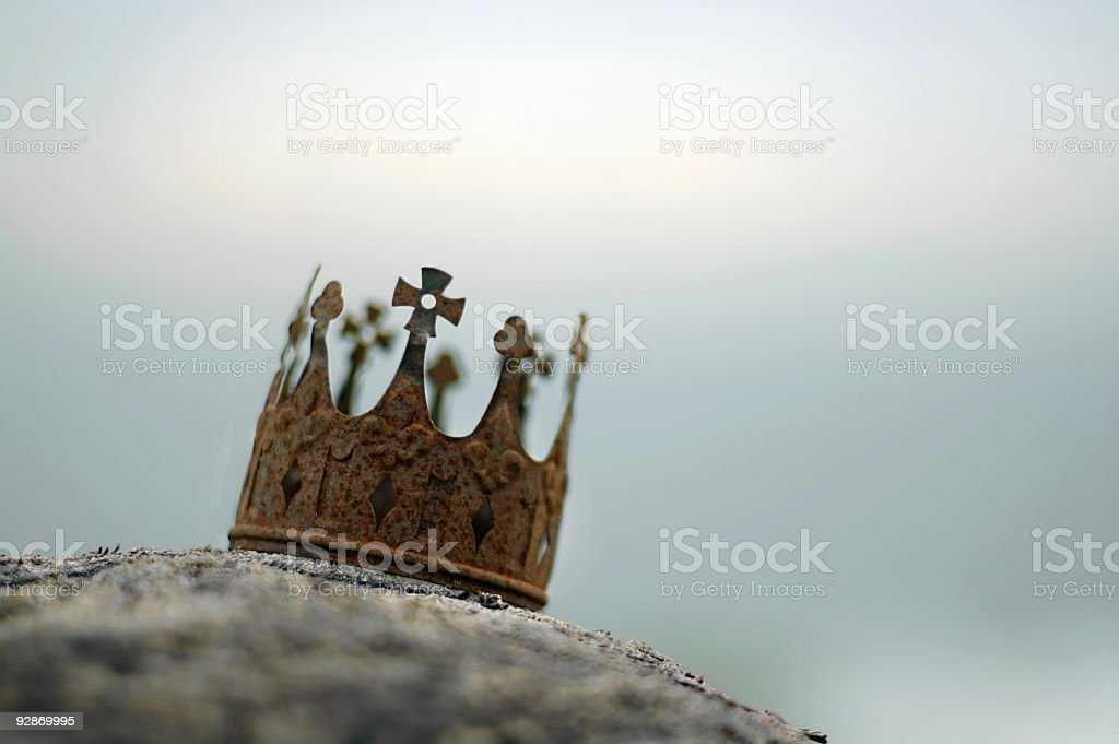 Close up of rusted crown on rock stock photo