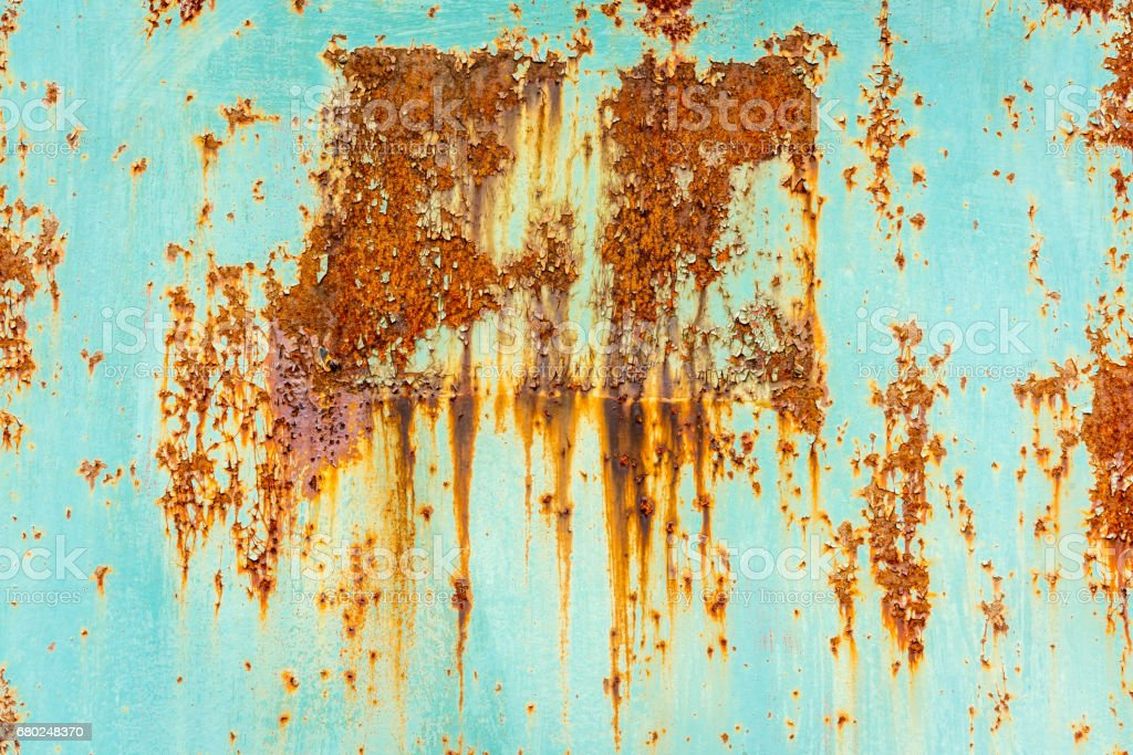 Close up of rusty flaking steel plate with light blue color. stock photo