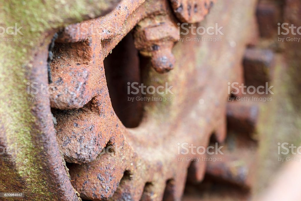 Close up of rusty gear on abandoned farm equipment stock photo