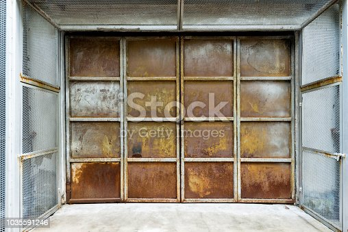 istock Close up of rusty metal door 1035591246