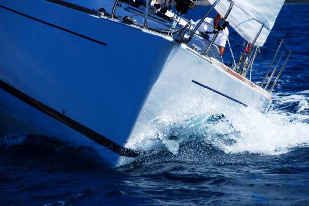 close up of sailing boat, sail boat or yacht at sea - hull stock pictures, royalty-free photos & images