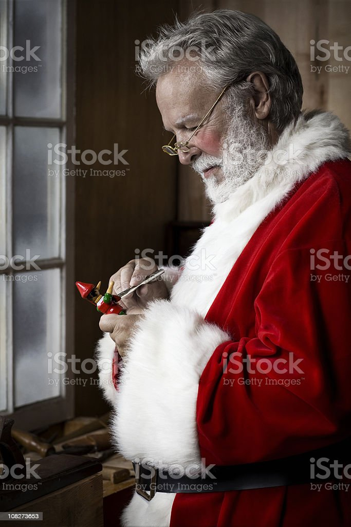 Antique Workshop with Santa Claus Painting Toy, Copy Space stock photo