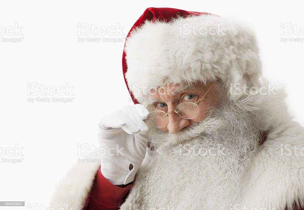Close up of Santa claus touching his eye glasses stock photo