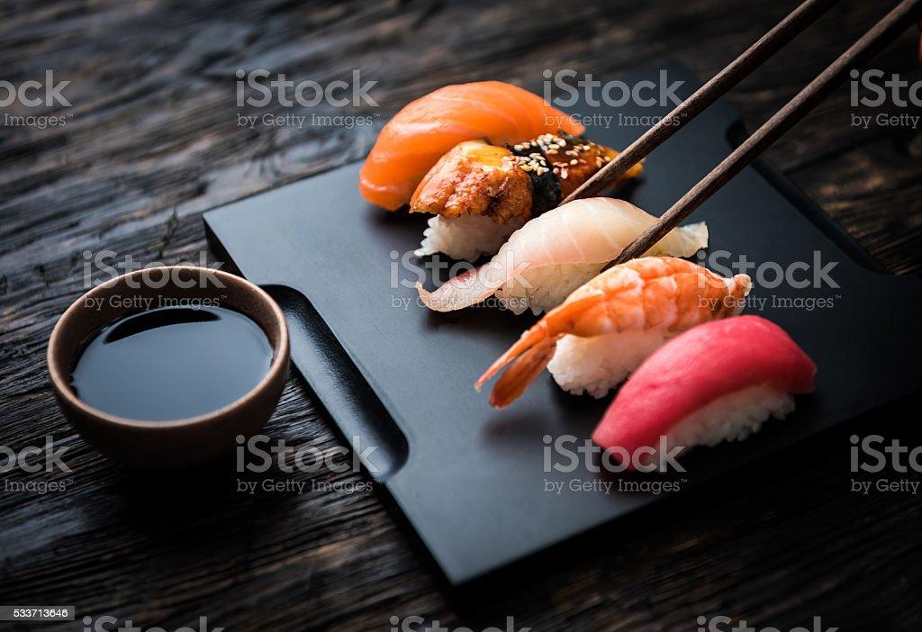 close up of sashimi sushi set with chopsticks and soy stock photo