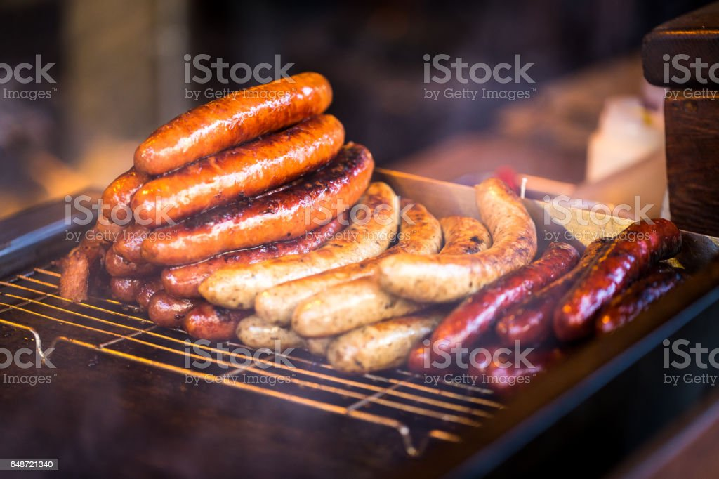 Close up of Sausages cooking on the grill at the market stock photo