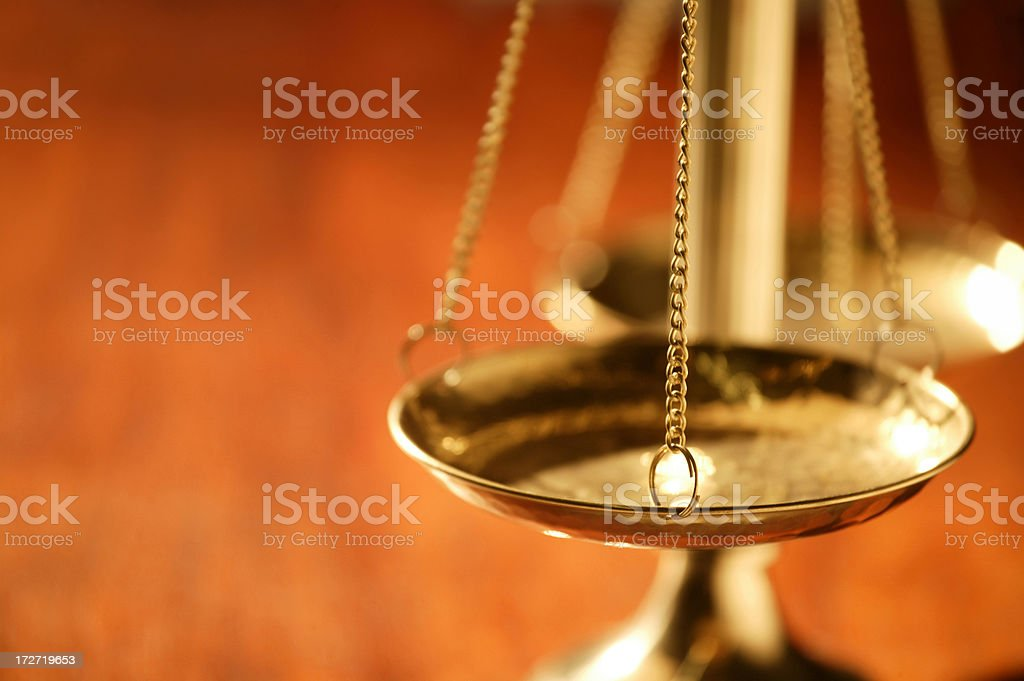 Close up of scale of justice tray on wood table royalty-free stock photo
