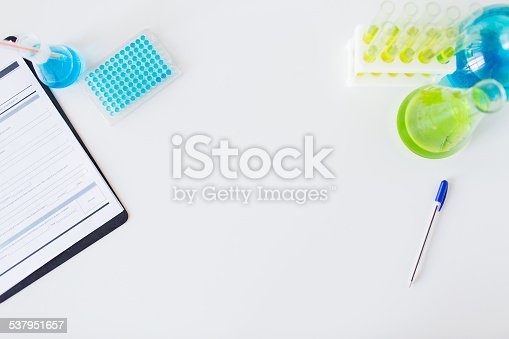 science, chemistry, biology, medicine and advertisement concept - close up of scientific laboratory table with stuff