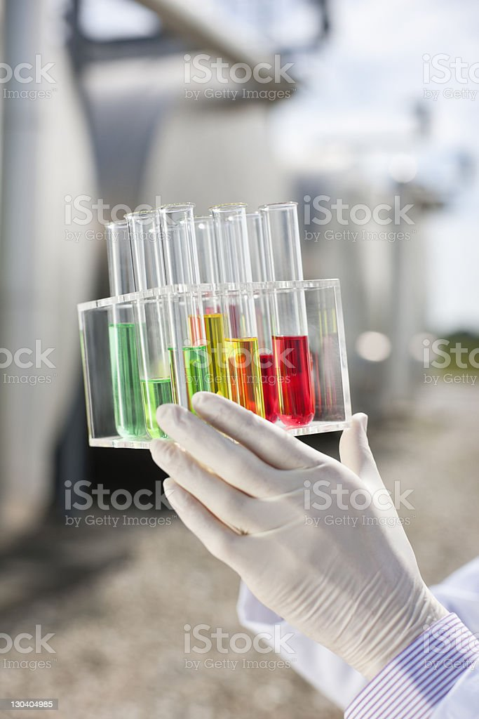 Close up of scientist holding test tubes royalty-free stock photo
