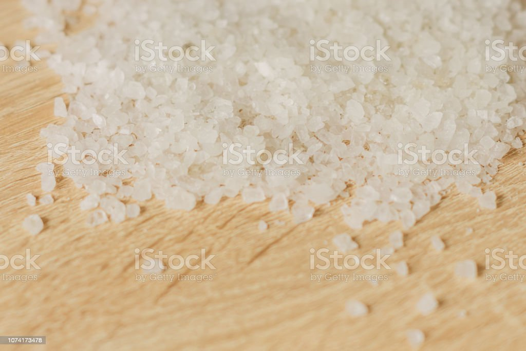 close up of sea salt for cooking and aromatherapy on wooden...