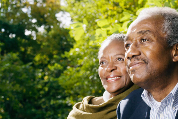 Close up of senior African couple smiling outdoors stock photo