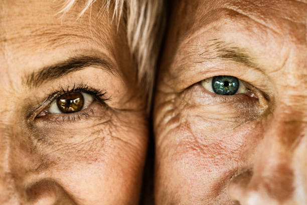 Close up of senior couple looking at camera. Close up of mature couple looking at camera. close to stock pictures, royalty-free photos & images