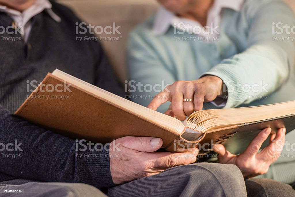 Close up of senior couple with photo album stock photo