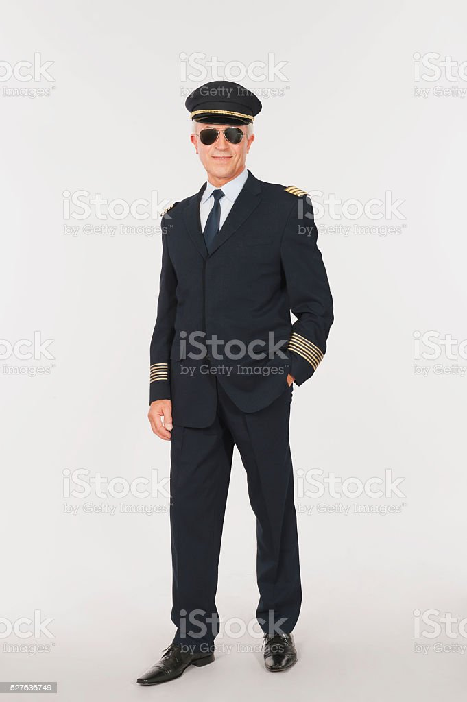 Close up of senior flight captain standing on white background stock photo