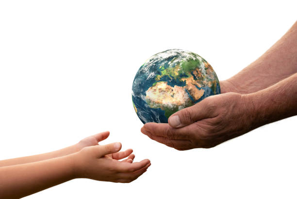 Close up of senior hands giving small planet earth to a child. Element of this image furnished by NASA ( https://earthobservatory.nasa.gov/blogs/elegantfigures/2011/10/06/crafting-the-blue-marble/ ) stock photo