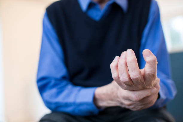 Close Up Of Senior Man At Home Suffering With Arthritis stock photo