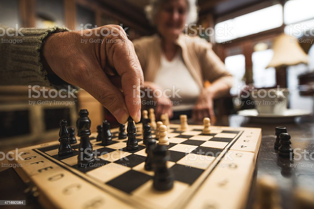 Close up of senior playing chess. stock photo