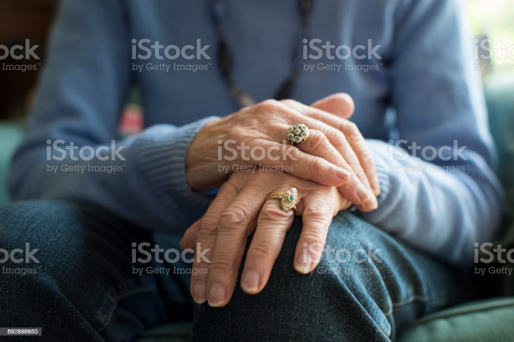 Close Up Of Senior Woman Suffering With Parkinsons Diesease stock photo