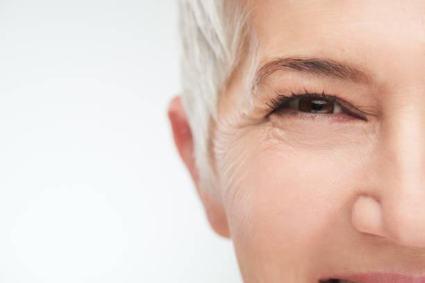 Close up of senior woman`s eye. stock photo