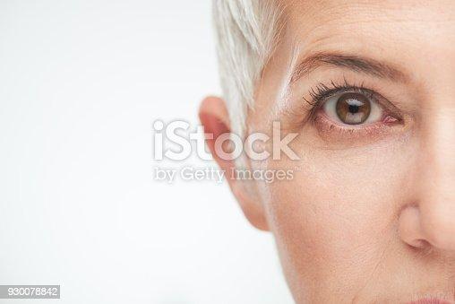 istock Close up of senior woman`s eye. 930078842