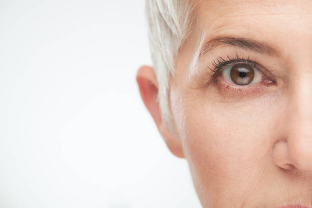 Close up of senior woman`s eye. stock photo