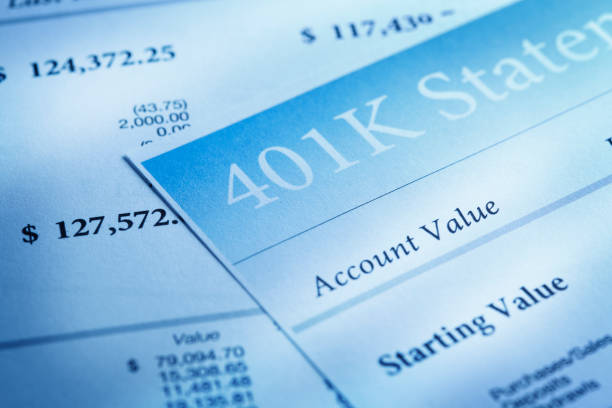 Close Up Of Several 401k Statements Light streams accross a close up of a 401k retirement statement. 401k stock pictures, royalty-free photos & images