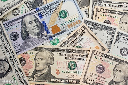 istock Close up of several dollar bills chaotically aligned 478690316