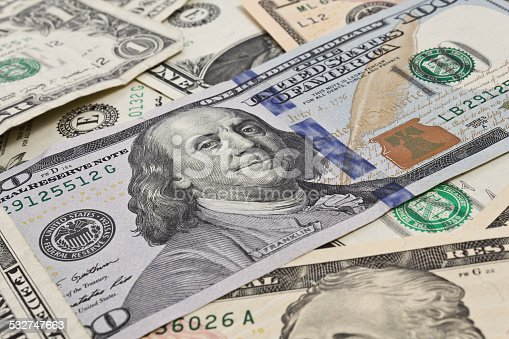 istock Close up of several dollar bills chaotically aligned 532747663