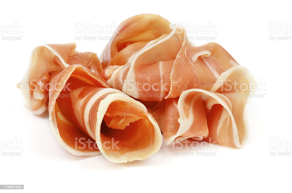 A close up of several rolled up pieces of fresh prosciutto  stock photo
