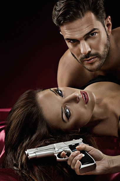 close up of sexy couple in bed - man dominating woman stock photos and pictures