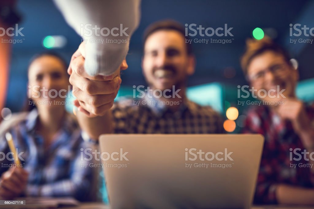 Close up of shaking hands after successful agreement. stock photo