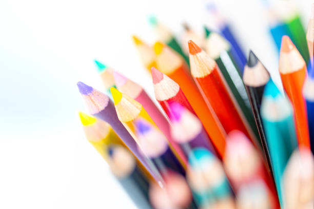 Close up of sharpened colored pencils. Shallow depth of field with blurred area surrounding center. Multicolored art supplies image. stock photo