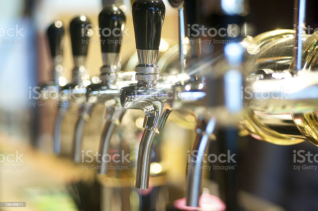 Close up of shining beer taps on a bar stock photo