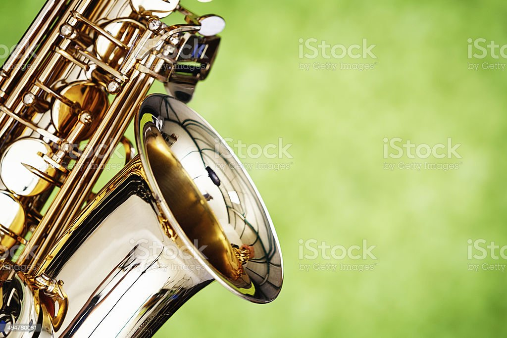 Close up of shiny alto sax on green background stock photo