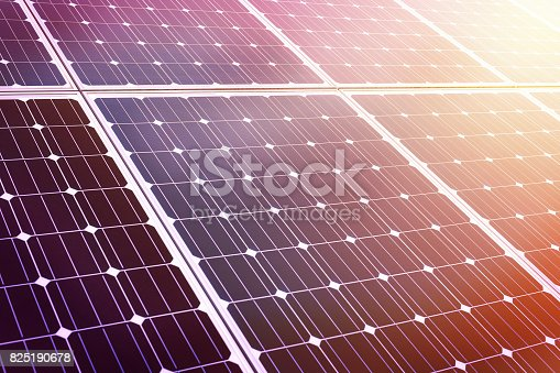 istock close up of shiny solar energy panel in sunset 825190678