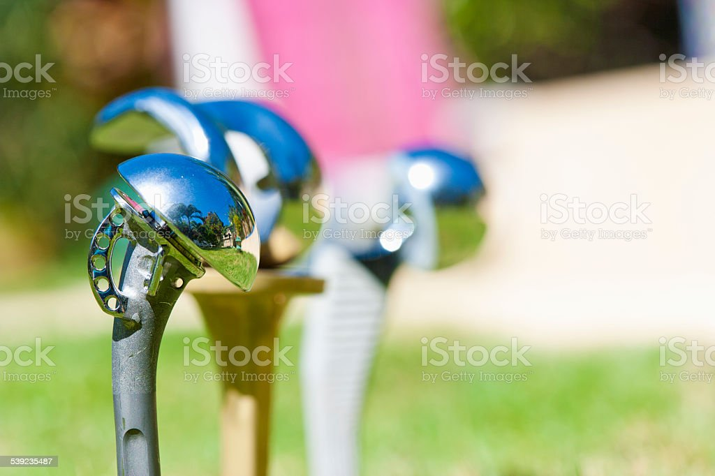 Close up of shoulder knee and hip prosthesis stock photo