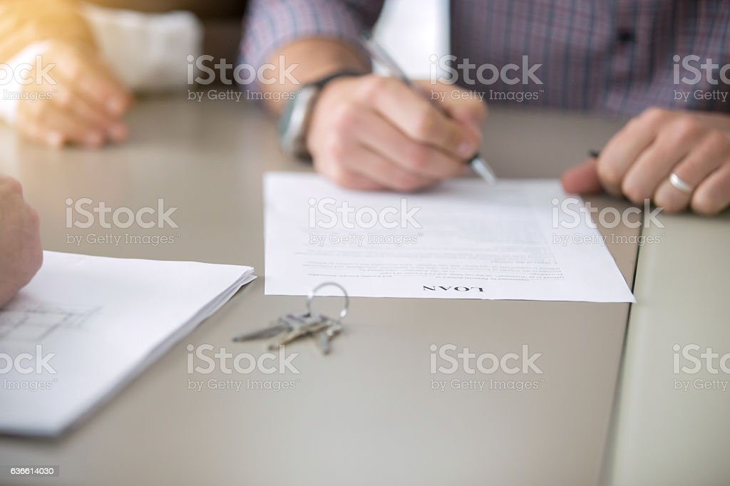 Close up of signing a loan stock photo