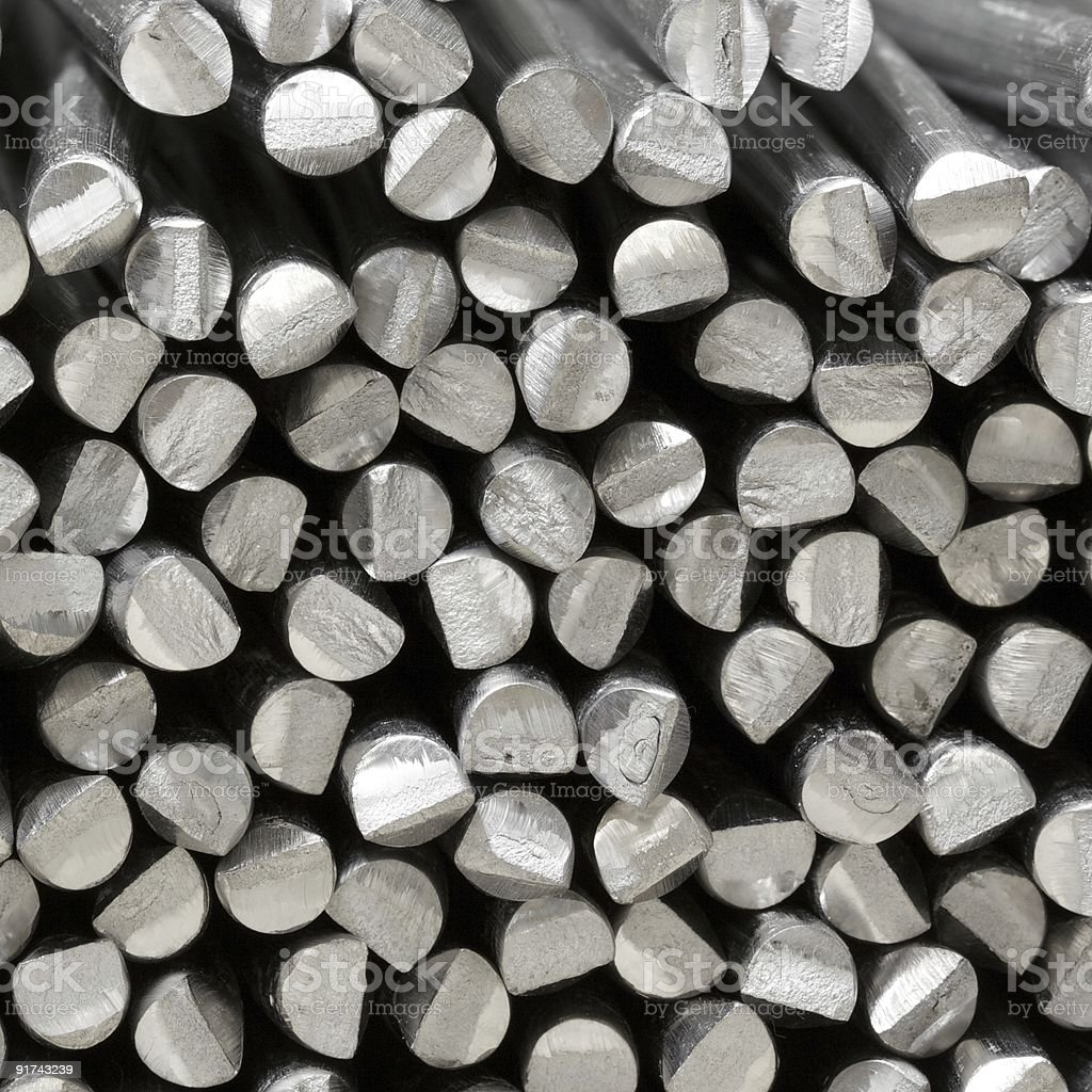 A close up of silver aluminum raw sticks stock photo