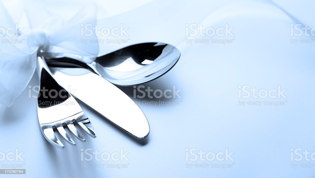 Close up of silverware wrapped with a ribbon royalty-free stock photo