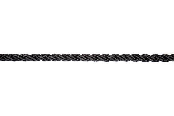 close up of single black rope line on white background stock photo
