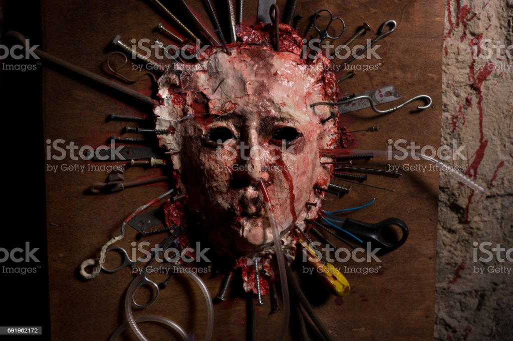 Close up of skinned bloody face of a person stretched stock photo