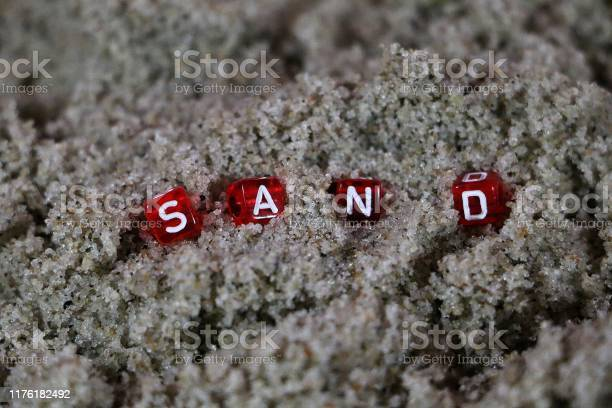 Close up of small red dices with white letters in the beachsand the picture id1176182492?b=1&k=6&m=1176182492&s=612x612&h=5n7jjtekzku5lw1akck69 dc7g6sej xpevq1ycrrom=