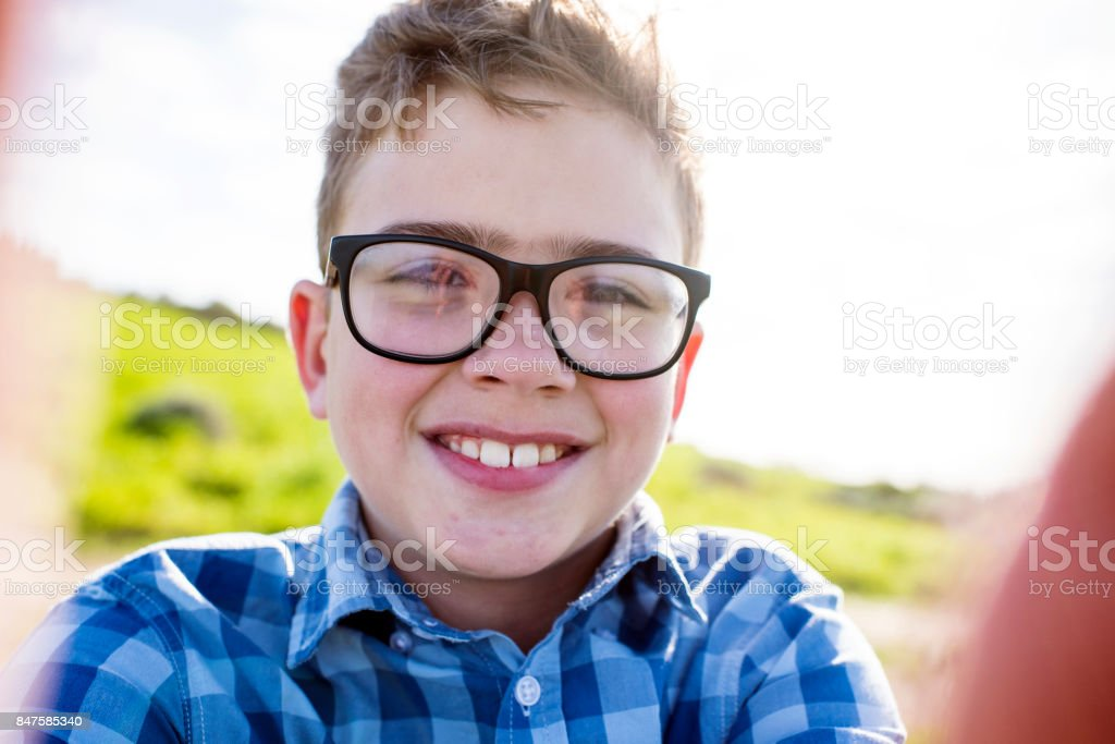 Close up of smiling happy boy stock photo