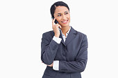 istock Close up of smiling saleswoman in telephone conversation 824887560