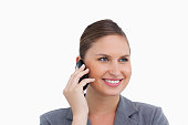 istock Close up of smiling tradeswoman on her mobile phone 824942784