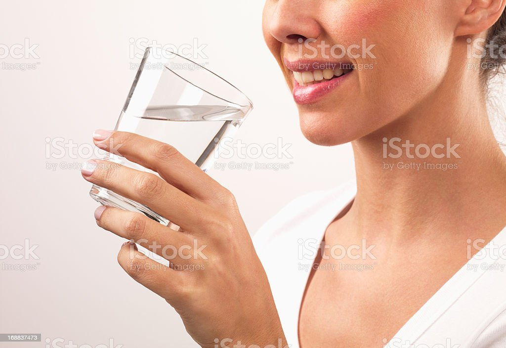 Close up of smiling woman drinking water royalty-free stock photo