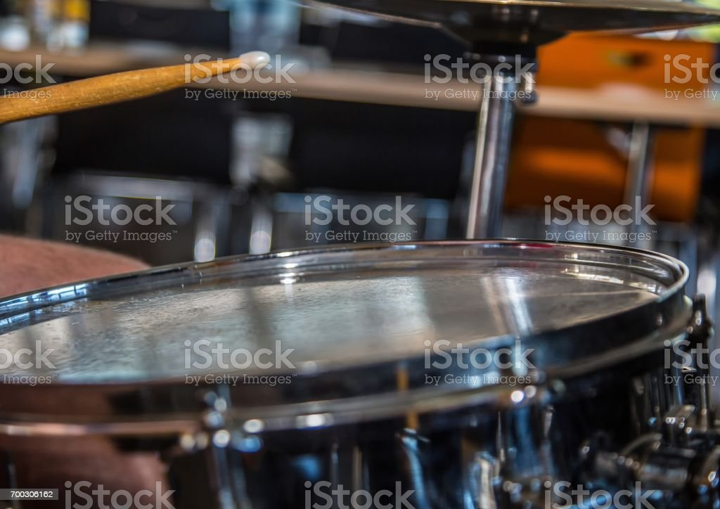 Close up of snare drum and a drum stick stock photo