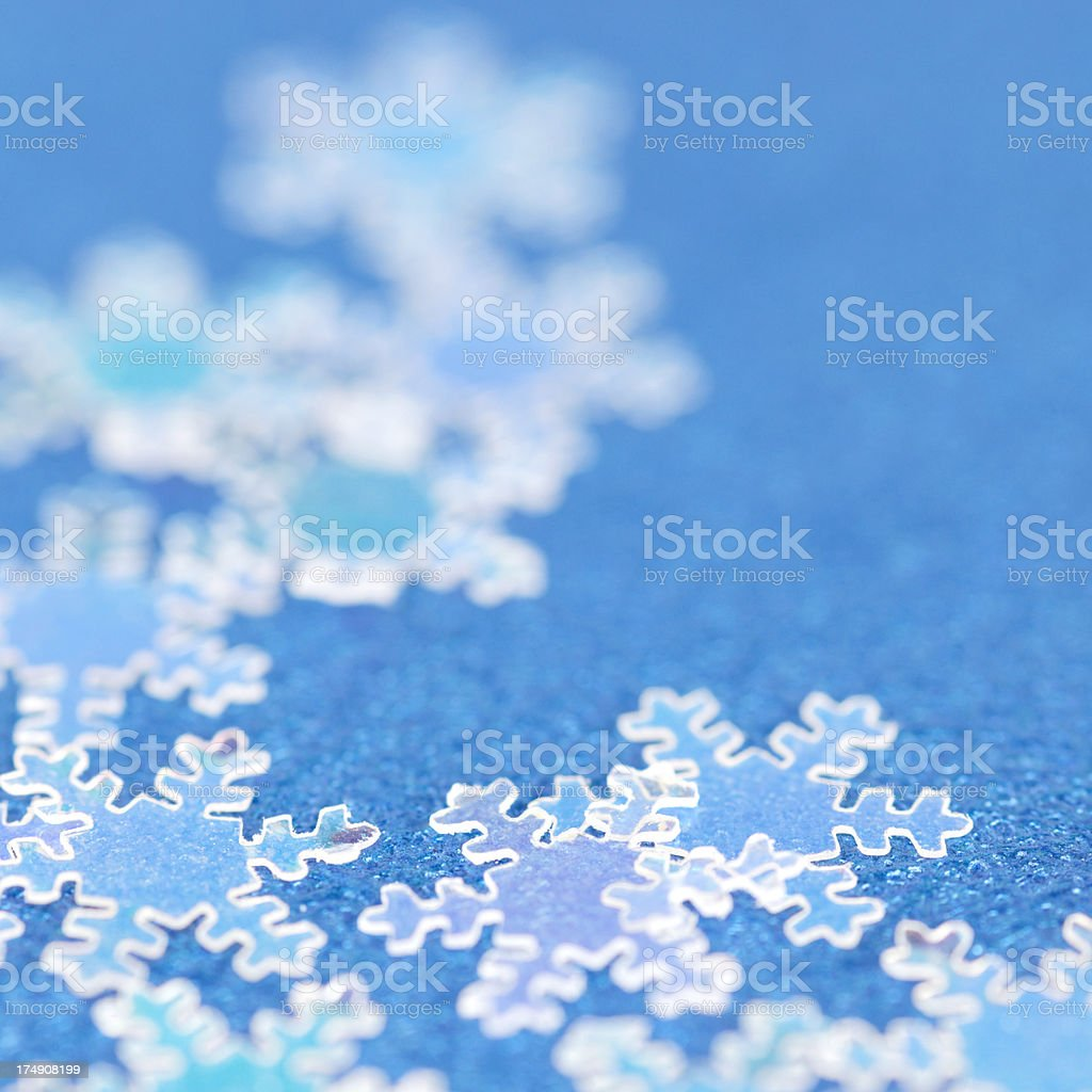 close up of snowflakes on blue surface royalty-free stock photo